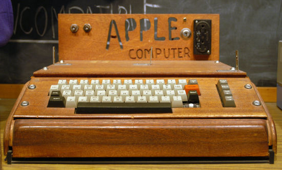 The Apple I computer in question, featuring a handmade wooden case.