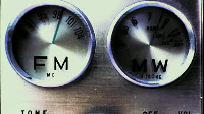stock-footage-an-old-vintage-portable-fm-and-mw-transistor-radio-with-the-marker-running-through-the-different